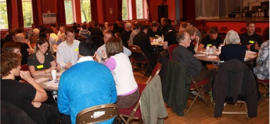 A Visioning workshop, with over 80 people working individually, together and at tables, supported by Bron Afon facilitators